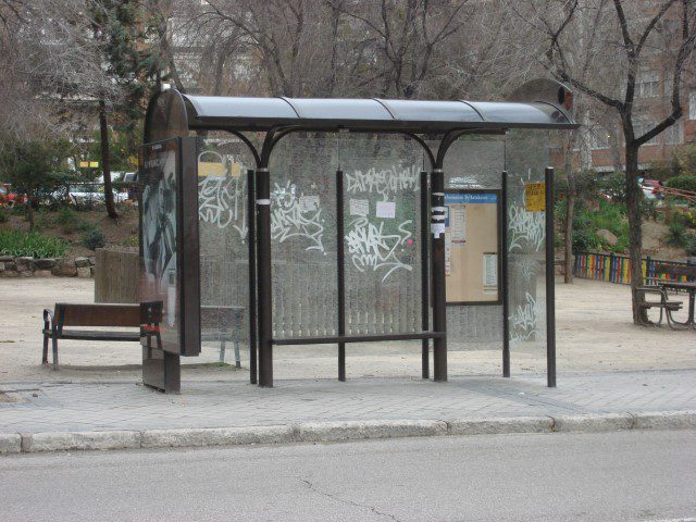 Image of an empty bus stop.
